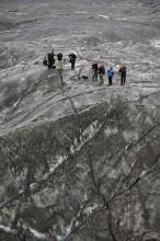 exploring an ash-covered glacier