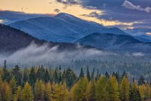 Algonquin Peak with in November with snow dusting, fog over tamaracks from Van Hoevenberg area