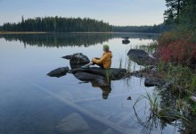 woman,sitting,tranquil,morning,cold,fog,over,lake,pond,looking out,looking,across,restful,contemplative,mood,calm,still,
