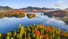 Boreas Pond and the Adirondack High Peaks Range with morning fog