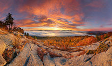Cat Mountain summit rocks sunrise over Lake George, 180 degree double row panorama