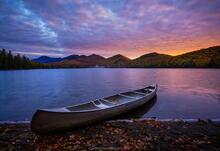 Clear Pond and aluminum canoe parked at sunrise, Elk Lake Preser