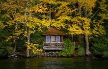 Lake Placid shoreline cottage tucked under trees, Lake Placid