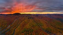 Gore Mountain Ski Area trails firey sunset behind summit during Harvestfest - dbl row pano