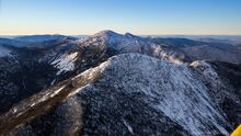 Mt. Haystack with Mt Marcy behind winter plane aerial view
