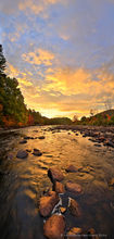 Hudson River riverbed rocks brilliant sunrise vertical panorama, near North River