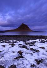 Kirkjufell beyond brittle sea ice sheets