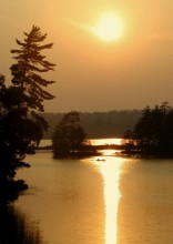 canoe,canoeist,canoeists,canoeing,hazy,summer,evening,setting,sun,still life,calm,tranquil,peaceful,vacation,shimmering,