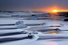 Ocean surf and icebergs near Jokulsarlon