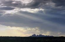 Uluru,Kata Tjuta,National Park,Ayers Rock,sandstone,monolith,Outback,Australia,Nothern Territories,blue,sun,rays,shining