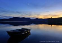 Lake Eaton,Lake Eaton campsite,aluminum boat,boat,floating,calm,evening,rising,moon,2014,Owls Head Mt,