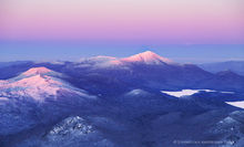 McKenzie Mt and Whiteface sunset light, winter aerial 2016