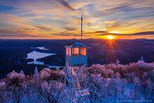 Mt. Arab Firetower window panes catching a winter sunset's last light