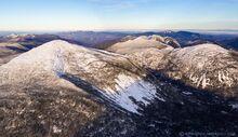 Mt Marcy slides and Mt Haystack behind winter plane aerial