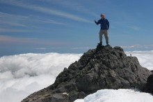 Mt. Taranaki, summit, climber, above, clouds, thumbs up, New Zealand, peak