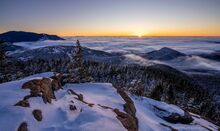 Noonmark Mt dawn over eastern lowlying clouds January 2021
