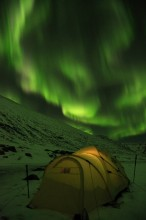 Northern Lights over tent in Iceland