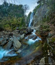 Rainbow Falls in early spring with evening moon, Ausable Club