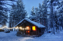 A cabin radiating warmth in the snowy forest
