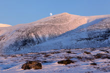 The moon rising over the mountains in Abisko, Sweden