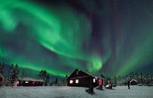 Aurora borealis over a cabin near Kiruna, Sweden