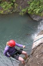 Tanya Rappelling on Kitekite Falls