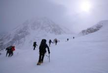 climbers in high winds on Denali
