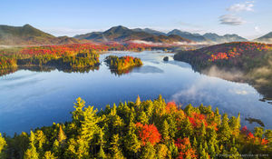 Boreas Pond and the Adirondack High Peaks Range with morning fog