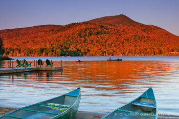 Blue Mountain Lake canoes with sunset light on Blue Mt