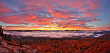 Cat Mountain brillitant red sunrise over Lake George valley fog