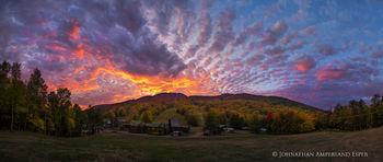 Gore Mountain ski center base area under blazing autumn sunset
