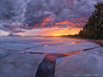 Lake Eaton springtime ice sheet cracks reflecting a brilliant April sunset