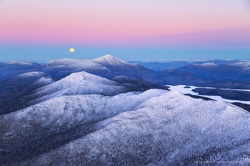 McKenzie Mt and full moon-rise over Whiteface Mt (aerial)