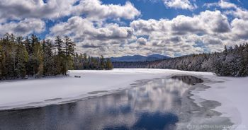 Second Pond boat launch on the Saranac Lakes with deer crossing in late winter