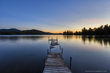 Silver Lake submerged dock pointing to Whiteface Mt at dusk