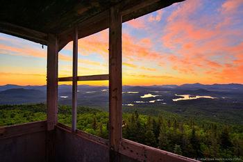 St Regis Mt Firetower cabin window view of sunrise of St Regis Lakes