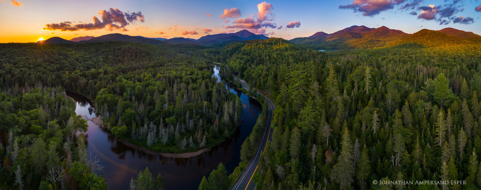 AuSable River section along River Road from a drone with Whiteface Mt in background