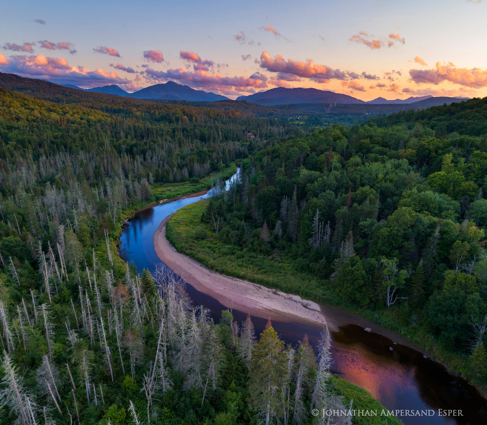 AuSable River section along River Road from a drone with the Olympic ski jumps and the High Peaks in background