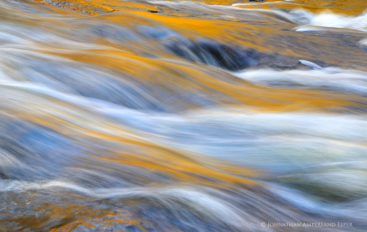 Buttermilk Falls,gold reflections,abstract,Buttermilk Falls smooth gold reflections abstract,fall,2014,rapids,current,smooth water,water detail,water abstract,motion abstract,Raquette River,Adirondack, photo