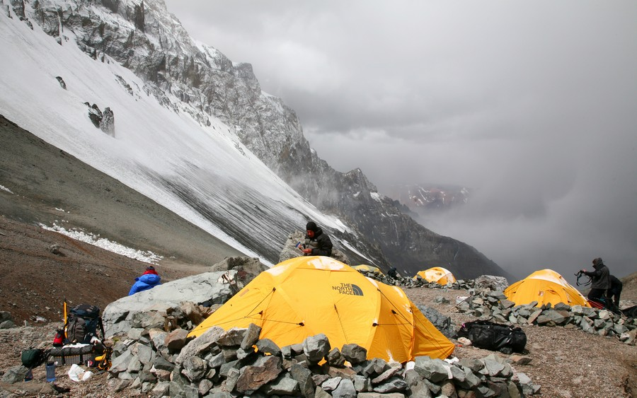 An interesting shot from Camp 1 at 16200ft, of three mountaineers, the left one resting and looking at the view, the middle one...