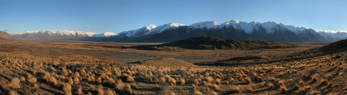 Erewhon Park in a remote area of the Southern Alps mountain range of New Zealand. The hill in the center of the plain is one...