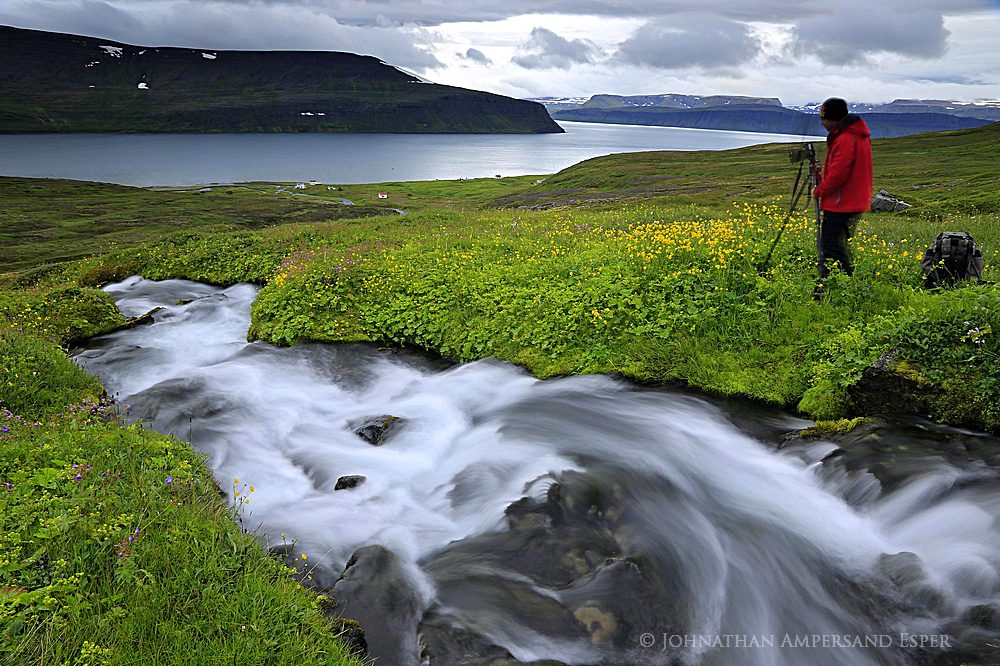 Hesteyri, Hornstrandir Peninsula, Westfjords, photographer by stream on an overnight excursion by boat while on tour with Johnathan...