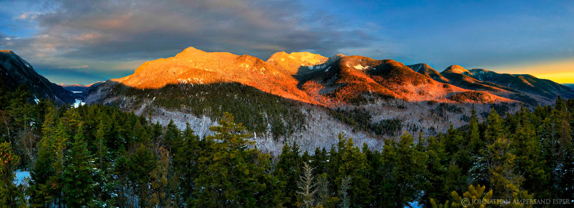 Sawteeth, Gothics, Armstrong, Upper and Lower Wolf Jaw of the Great Range in sunrise winter light from a pine Treetop on Indian...