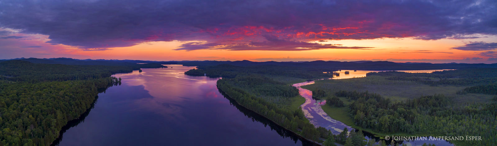 Little Tupper Lake and outlet into Round Lake, summer sunset aerial 150 degree panorama, Whitney Wilderness area, Adirondacks