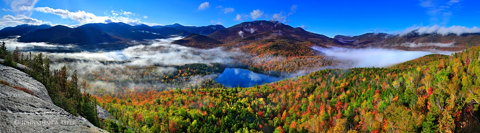 Mt. Jo panorama over valley fog, Heart Lake, and the Adirondack High Peaks, fall 2011. A panoramic composite of 8 images for...