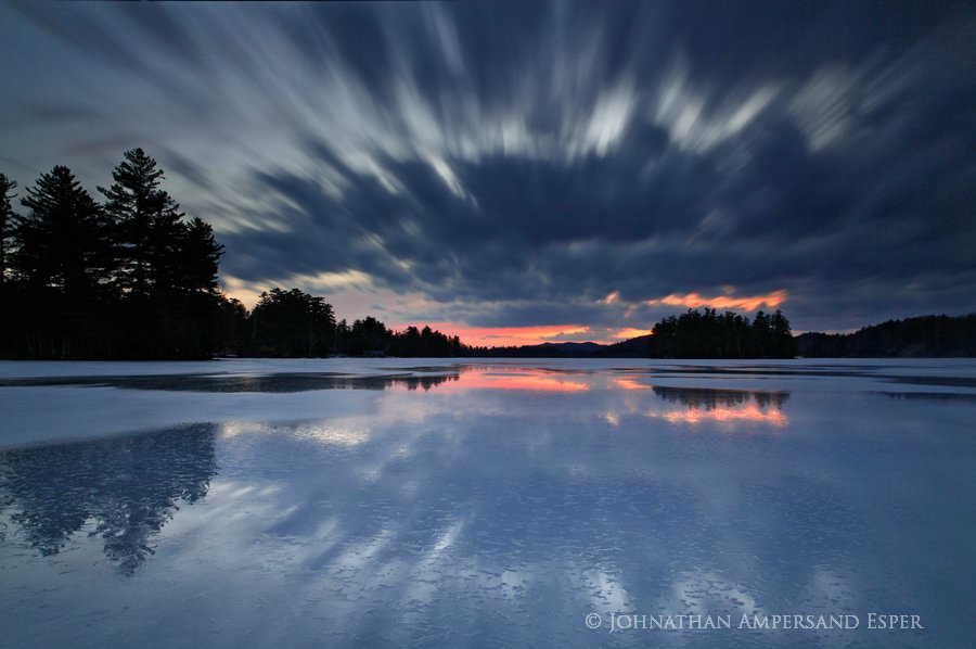 A 30 second exposure of clouds reflected in springtime meltpools on Raquette Lake