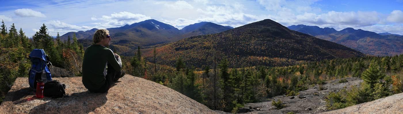 Great Range,hiker,hike,views,vista,worth,effort,rest,resting,sitting,rock,summit,sunny,fall,dayhike,Noonmark Mt,Round Mt, photo
