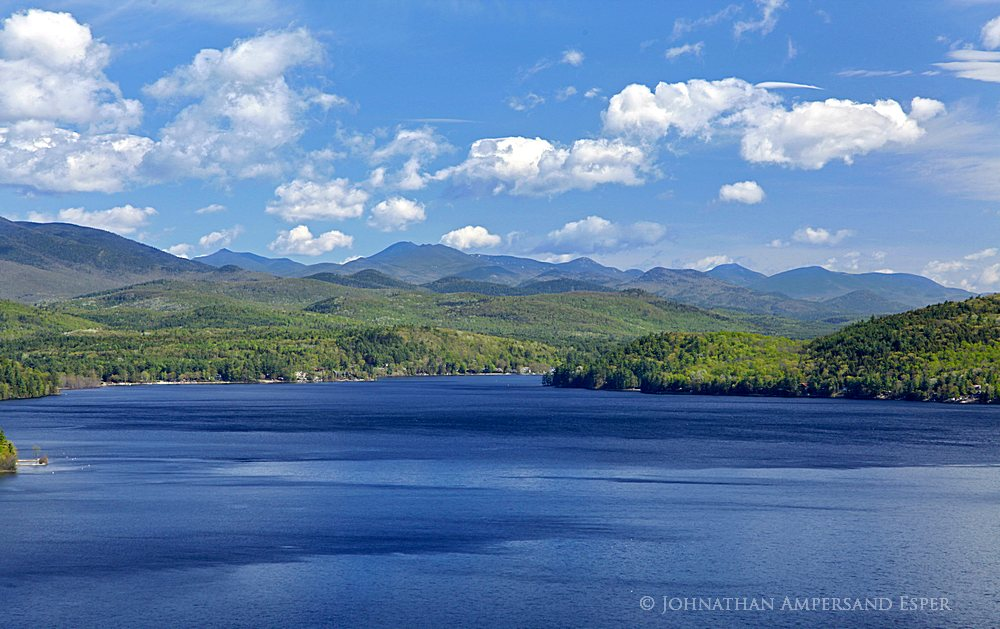 Schroon Lake telephoto view with the High Peaks (Dix Mt and Giant Mt) to the north, from a treetop on Schroon Lake's southeast...