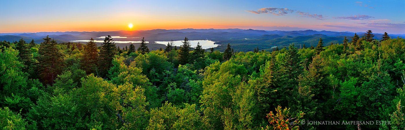 Speculator Mt. summit 180° Treetop panorama of a June sunset over Lake Pleasant and Sacandaga Lake, Adirondack Park.