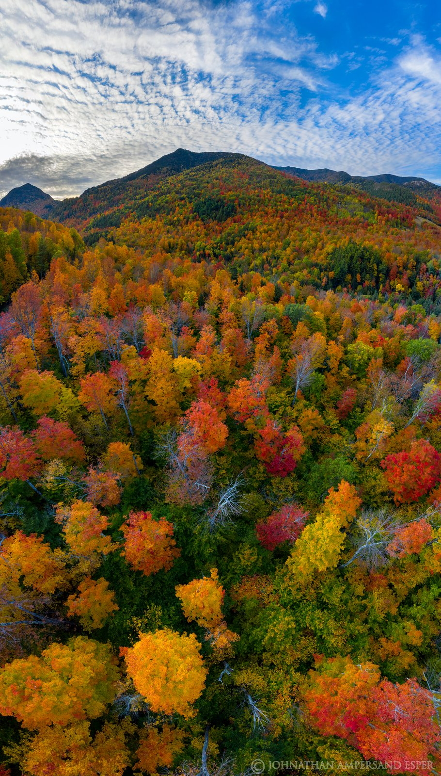 Whiteface Mt rising above the colorful forest near High Falls Gorge